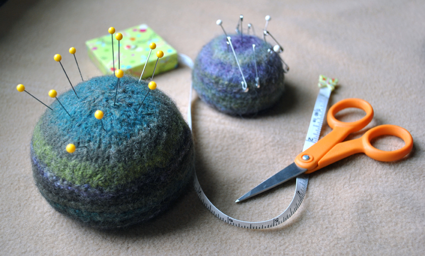 photo of felted pincushion with scissors & measuring tape