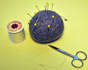Pincusion with needle & thread and scissors