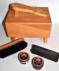 Wooden shoeshine box with cleaning supplies