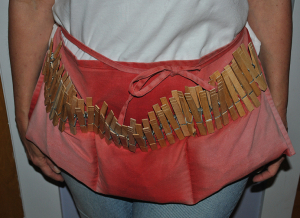 clothespins in waitress apron