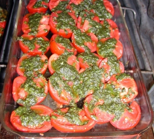 pans of tomatoes with basil drizzle