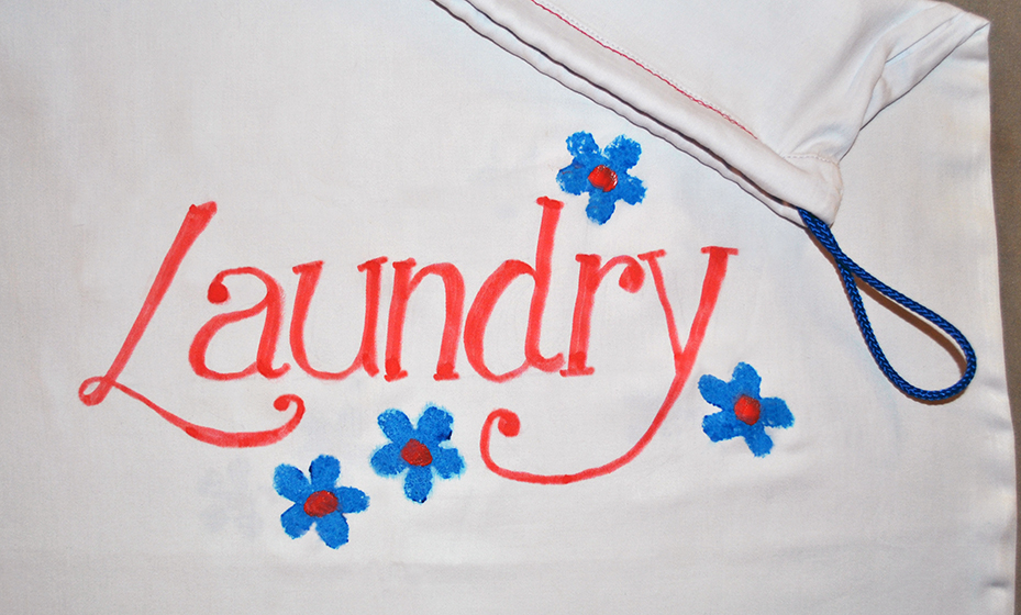 Laundry bag with freehand lettering and embellishing