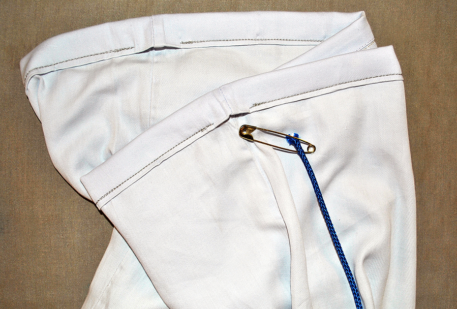 Inserting the drawstring into the casing