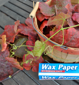 Basket of select grape leaves and wax paper roll