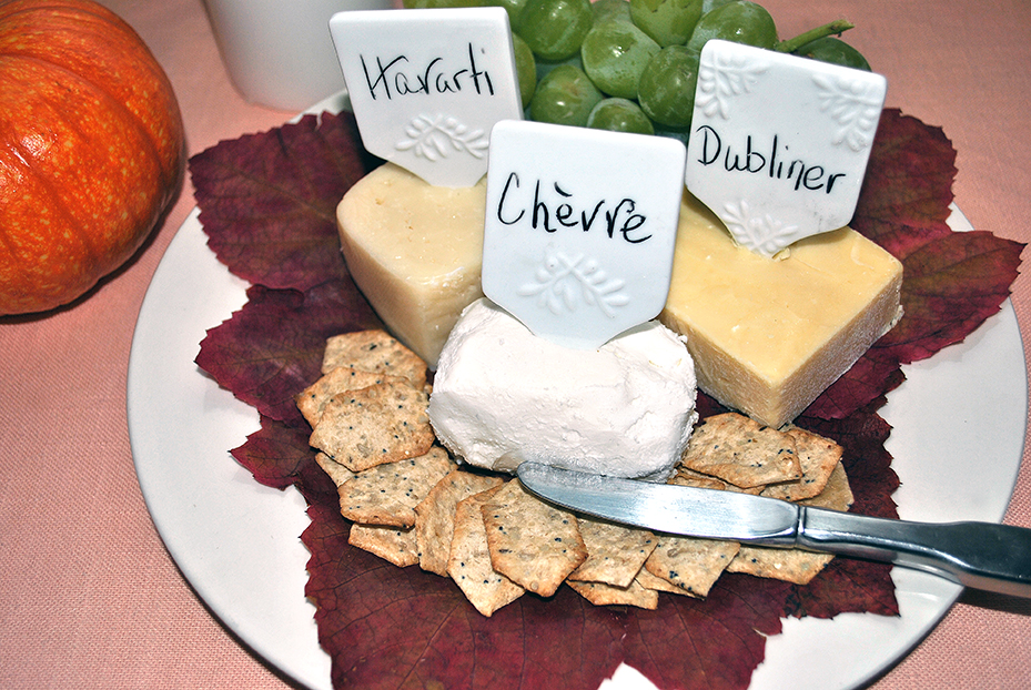 Finished product: cheese plate with grape leaves set up for entertaining