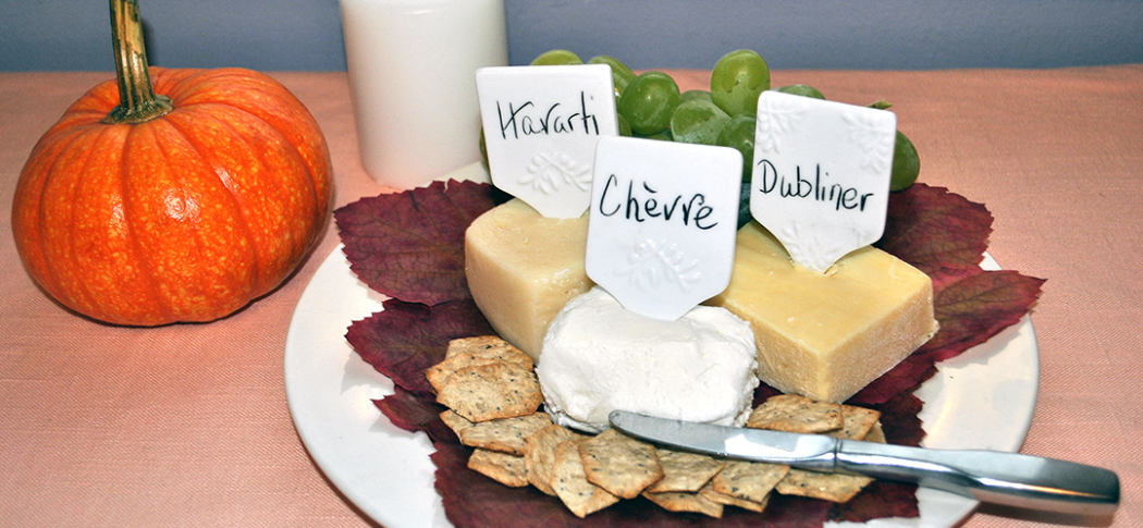 Cheese plate with grape leaves