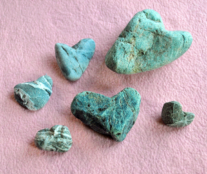A collection of green heart-shaped rocks