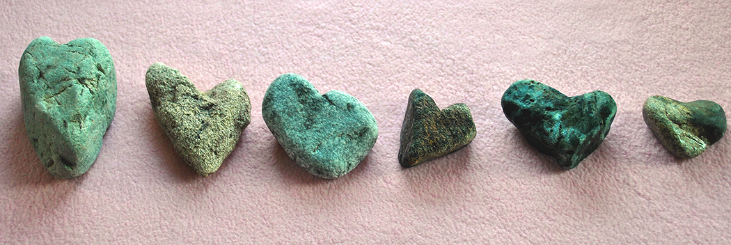 A row of heart-shaped rocks
