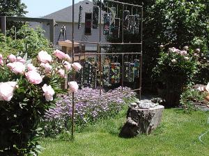 Peony bushes flank garden art