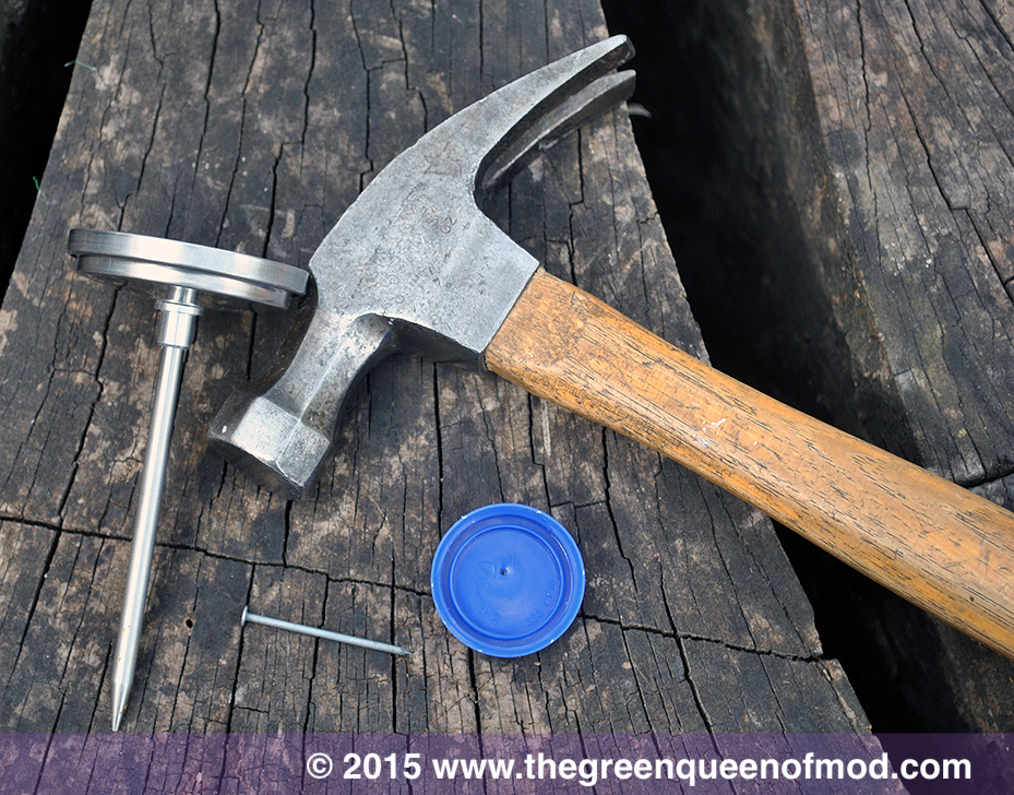 Milk jug lid, hammer & nail